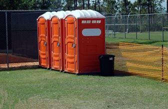 Orange portable toilets
