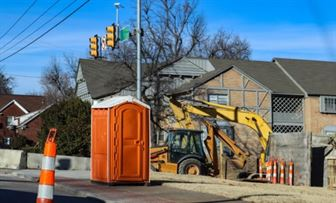 Orange portable toilet