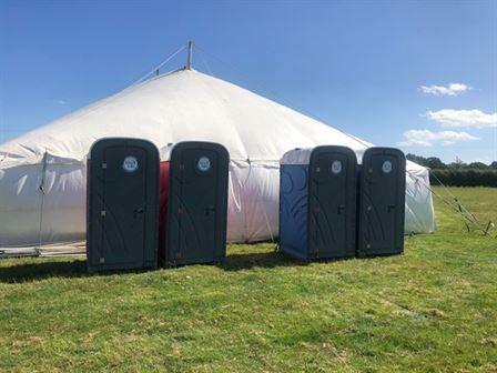 Toilets in a field