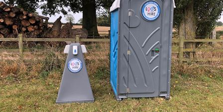 hand wash station next to portable toilet