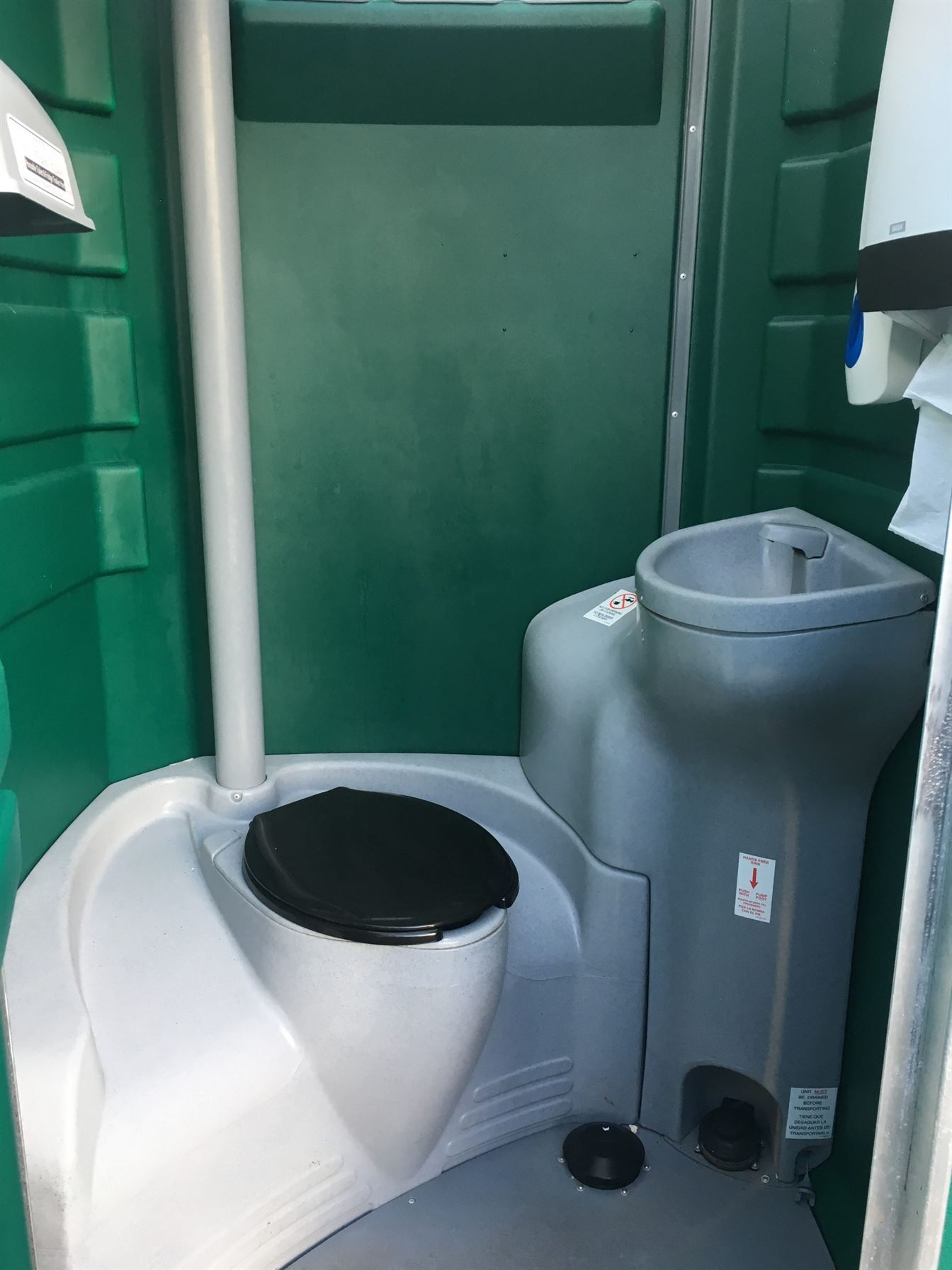 The inside of a premium portable toilet by Loos for Hire