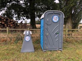 hand washing station stand next to portaloo in Northampton